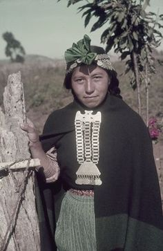 Chile   Araucanian woman with elaborate silver jewellery.   ©W Robert Moore