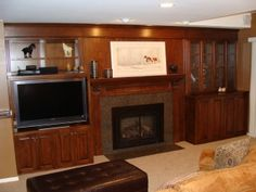 Built in around fireplace. not so dark and stodgy though Built In Around Fireplace, Tv Fireplace, Custom Fireplace, Fireplace Surrounds, Fireplace Ideas, Built In Wall Units, Entertainment Center Wall Unit, Low Cabinet, Upper Cabinets