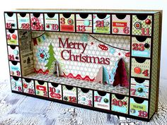 advent drawers with a shadow box-esque twist. would be great to have a nativity scene in the middle, or maybe even snow day fun, hills and kids sledding? hmm.