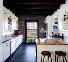 Spacious kitchen with exposed brick wall