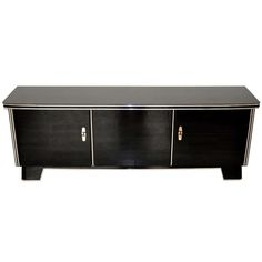 Magnificent Art Deco Lowboard   From a unique collection of antique and modern sideboards at http://www.1stdibs.com/furniture/storage-case-pieces/sideboards/