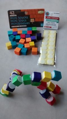 DIY Toddler activity-Velcro Lego! Dollar store craft blocks and velcro dots! $2 total cost. Awesome for plane rides!