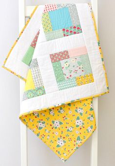 ~ This modern baby quilt is handmade featuring bees on flowers, strawberries, vines, red, mint, yellow, white, teal nursery prints will complement your baby girls modern neutral nursery. ~ All my Love Bug Baby Quilts are handmade using 100% cotton fabrics in the latest colorful