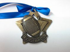 Gold Colored Football Star Christmas Ornament by GiftWorks. CLICK NOW FOR FREE SHIPPING, $8.95 EACH.
