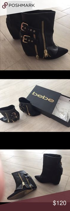 "Bebe wedge black boots Very stylish, 4"" wedge bootie, with gold buckle and zippers on the right side, pointed toe, mixed fabric. bebe Shoes Ankle Boots & Booties"