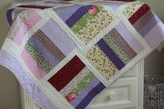 """A romantic baby quilt with the pattern """"Piece of cake"""" by Camille Roskelley."""