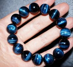 Deep blue tiger eye prayer beads.Blue Tigers Eye - also known as Hawks Eye, enhances integrity of communication and practical communication. It can help find courage to recognize thoughts and ideas, and the willpower to carry them into the physical realm. Blue tigers eye can be used for protection, especially of the upper chakras. It is also said to bring good luck to one who wears or carries it. Blue tigers eye is associated primarily with the throat chakra.