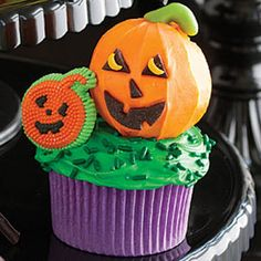 Pumpkin Patch Cupcakes- Decorating these scrumptious, colorful delights will keep the kids entertained for hours. Check out more Halloween baking ideas at Redbookmag.com.
