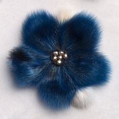 Beautiful flower broaches made from leftover sealskin pieces. Nothing is wasted. To be worn on hats, lapel, mitts, bags, etc. Sewing for Survival; by Rannva; Apex Nunavut