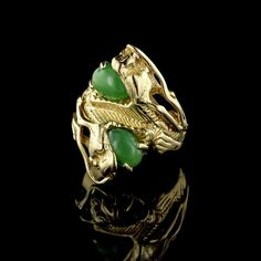 How cool is this edgy 14K yellow gold double dragon head Jade ring?!