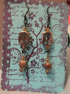 """copper and glass focal beads ; copper colored  beads ; black findings        2 1/2"""" long  product #E030 $10.00"""