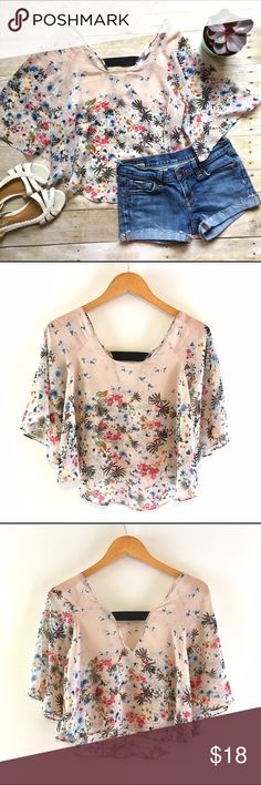 """Zara sheer flutter sleeve boho festival top Perfect top for festival season! Add a colorful bandeau and cut offs for an easy cool girl look. Also looks cute with high-waisted pants! In excellent condition. Flutter sleeve. Scooped neckline in front and back, back has a cool black ribbon band. Polyester. 23""""L in front, 18""""L in back. Size XS. Zara Tops"""