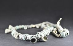 Amlash bronze rneckalce with beads restrung, 1st millenium B.C. 45 cm long. Private collection