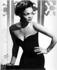 """Eartha Kitt: Eartha Kitt hit it big in 1953 with her song """"Santa Baby."""" She also showed off one of the era's most fashionable hairstyles: short, voluminous waves created with a hot comb and rollers."""