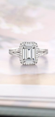 This exceptional setting features a halo of diamond accents that curve gently around the center diamond for a distinctive look. This exceptional setting features a halo of diamond accents that curve gently around the center diamond for a distinctive look. Halo Engagement Rings, Halo Rings, Solitaire Rings, Halo Diamond, Diamond Rings, Emerald Cut Aquamarine Ring, Sapphire Rings, Ruby Rings, Gold Ring