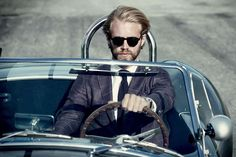 Fast cars and fine suits.