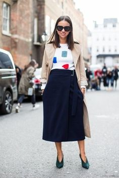 A nude trench and a dark blue midi skirt are a combination that every stylish girl should have in her wardrobe. Dark green suede pumps are a wonderful choice to complete the look.