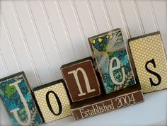 Mod Podge scrapbook paper onto wooden blocks and add vinyl lettering.