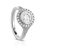 R605-1D - Sholdt Design. Bezel-set, pavé shoulder halo ring with 50 diamonds equaling 0.30 carats total weight.