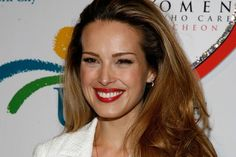 Petra Nemcova  Model who survived Aceh Tsunami and went on to found the Happy Hearts Fund.  Turning tragedy into purpose Try inspiring!!  Love her :).