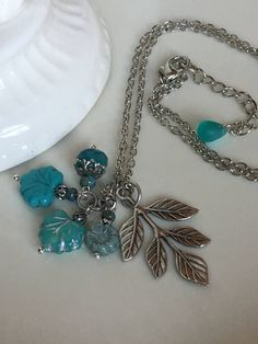 A personal favorite from my Etsy shop https://www.etsy.com/listing/512590792/turquoise-teal-blue-silver-leaf-maple