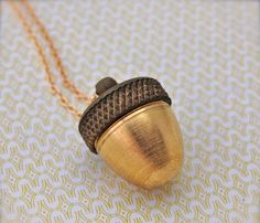Acorn Canister Necklace - twists off revealing the perfect little place for special keepsake.  Love it!