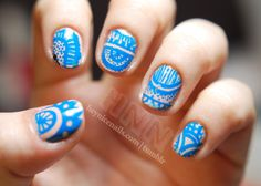 """the base coat is  CND """"Perfectly Bare"""" and the """"doodles"""" are CND """"Anchor Blue"""""""