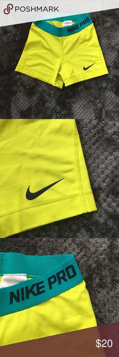 Nike Pro Spandex Neon yellow and blue Dri-Fit Nike Pro spandex. Used but good condition. Slight wear on Nike check (pictured). 80% polyester 20% Spandex Nike Shorts
