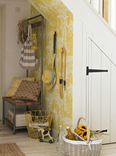 This small dark area under the stairs has been brightened with a brilliant zingy yellow wallpaper. Not forgetting the great storage ideas here too - the dual bench is inspired.