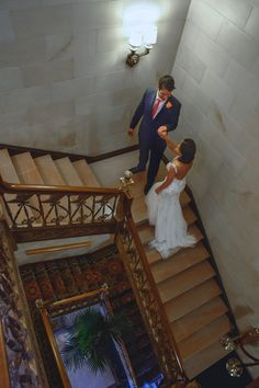 Indoor Wedding Photoshoot Ideas for couples and photographers. Bride & Groom indoor stairway. Ideas for Bride &Groom Portraits. This photograph was edited with our Indoor Wedding Lightroom Presets. Check them out at our website. http://www.louandmarks.com/shop-1/