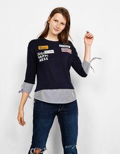 Camiseta mangas y bajo camisero parches. Descubre ésta y muchas otras prendas en Bershka con nuevos productos cada semana