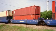 APLX #4873D 48' well car with APL containers swings through Oliver Junction on NS