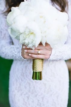 All white bouquet wrapped in gold rope: