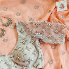 Beautiful saree n backless choli blouse with embroidery, worn with exquisite bali earrings. is in pastel peach, in cream. Saree Blouse Neck Designs, Bridal Blouse Designs, Blouse Patterns, Organza, Stylish Blouse Design, Stylish Sarees, Saree Dress, Lehenga Blouse, Indian Designer Outfits