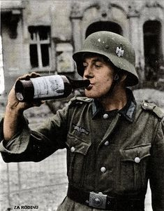 German soldier has a drink in Berlin 1943