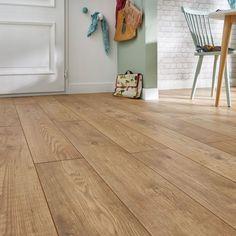 Un sol vinyle comme des lames de bois dans la salle à manger