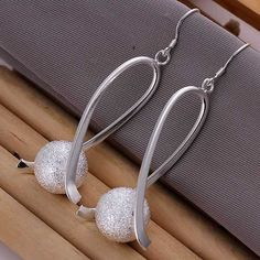 Silver plated Fashion Ball Earrings