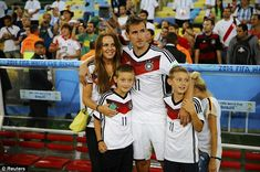 Family outing: Miroslav Klose and his wife Sylwia with their children after Germany won the World Cup