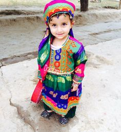 Little afghan girl with national dress