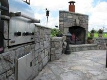 Outdoor fireplace and grill with stone