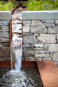 Stone and corten steel water rill and fountain