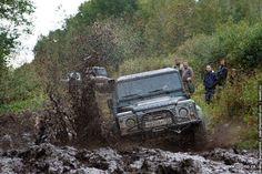 Land Rover spraying mud.