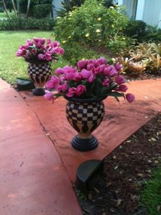 These flower pots were plain. She painted them with a McKenzie Childs look but they could be painted in any style.  Add some glam to the exterior of your home!