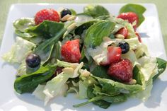 Iceberg, spinach, blueberries, strawberries, pine nuts and Sunset Gourmet's Creamy Vidalia Onion and Poppyseed Dressing. Awesome!
