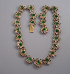 HOBE necklace with green and clear unfoiled rhinestones set in gold tone wire work