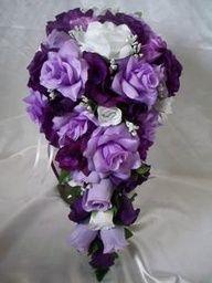 Purple wedding bouquet http://www.timelesstreasure.theaspenshops.com/product/wedding-bouquets.html