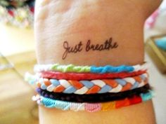 Love the colors in the bracelets.  I used to make these friendship bracelets when I was a little girl.  I still like them.  As for the tattoo, it's not unique at all, but I still kind of dig it.  We all need that reminder now and again, don't we.