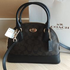 NWT Coach Mini Cora Domed Satchel NWT mini Cora domed satchel with removable long strap in brown/black leather with gold hardware comes with box Coach Bags Satchels