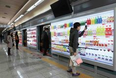 Homeplus (Belongs to  Tesco) launched virtual shopping stores in South Korea. Created with the busy person in mind, you can buy your groceries while waiting for the subway. After confirming the purchase on your phone you designate at what time you wish to have your groceries delivered to your house.