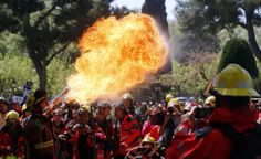 A fireman performs with fire during a protest against budget cuts in front of Catalunya's Parliament in Barcelona, Spain, April 10, 2014. REUTERS/Albert Gea